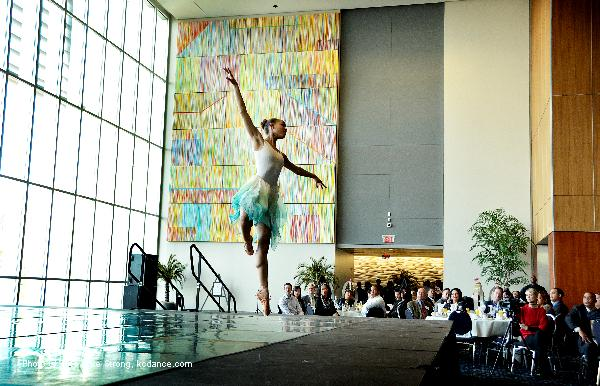 Miyesha McGriff in the air at the breakfast for Judith Jamison and Robert Battle as Judith hands the torch of artistic director of Alvin Ailey to Robert.