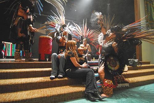 Santos receives a blessing in healing ceremony. Left-Right: XochiTecpatl, Tekolpoktli Madrid, Gabrielle, Santos, Temaquizciuni, Atezcazolli Perez, Nauhxayacatl Chavira - Azteca/Mexica dance at Guadalupe Center in Kansas City for Dia de los Muertos 1 Noviembre 2008