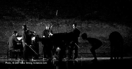 Brad Cox at piano, Jeff Harshbarger on bass - dancers hunched down in silhouette - in Fuga Tanguera by Jennifer Owen at A Modern Night at the Folly (by City in Motion) photo by Mike Strong - www.kcdance.com