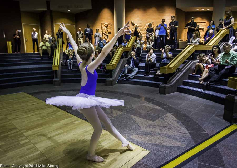 Young dancer from Crescendo Conservatory performs in lobby of the Carlsen Center