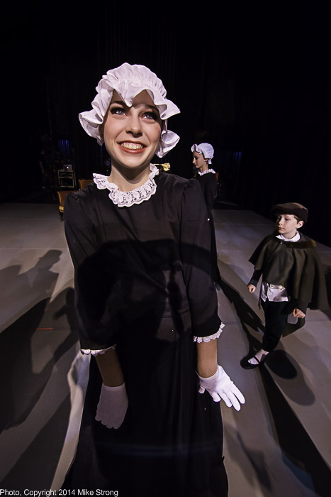 Anne Marie Dahms as maid in Act-I party scene, backstage before performance