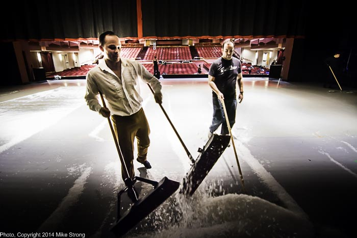 Dancer Dave Cross (left), playing one of the house guest parents and playing the Mouse King, pitches in to sweep snow to re-use it