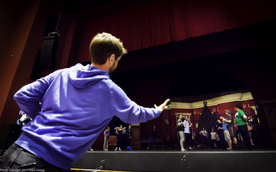 Kristopher Estes-Brown directing the party scene across the orchestra pit - (tech)