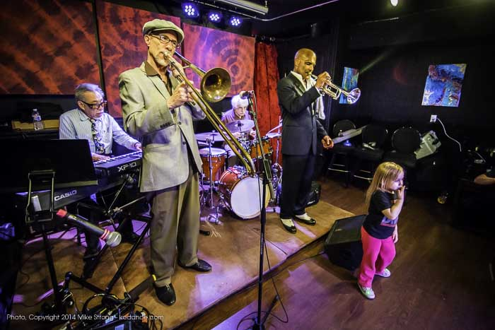 Mike Ning (Left, keyboards), Rich Hill (trombone), Victor Perlmutter (drums), Lonnie McFadden (trumpet) and Mike Ning's grandaughter