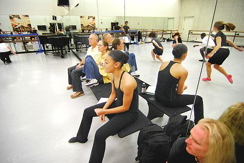 Chloe Abel (center) on the near end of the bench directing her arrangement of Twyla Tharp's piece. On the bench from far to near: William Whitener artistic director of Kansas City Ballet (KCB), Paula Weber Dance Division chair, and lighting guy E.J. Reinagel.