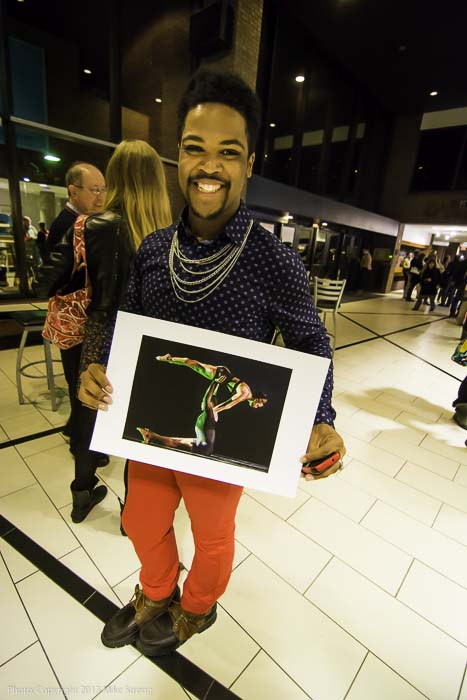 After the show Saturday night - Kameron Saunders holding a picture from Wednesday's dress of his performance in 'A Hint of Mischief' by DeeAnna Hiett in a lift with Simone DeLozier