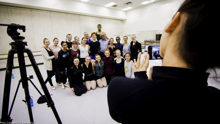 Caroline Dahm takes a picture of the Henriks dancers with choreographer Gregory Dawson (back row, light shirt, in front of DaJuan)