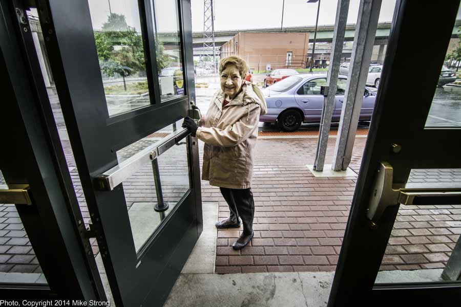 Billie Mahoney opens the door of Bolender Center to let me out, pushing my cart to my car, on a rainy day in summer.