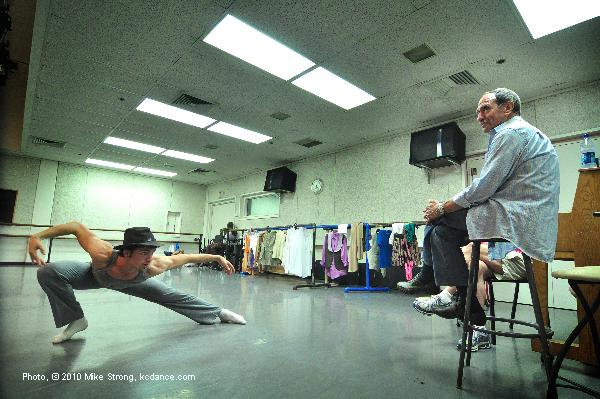 Bill Shapiro (right, on stool) in rehearsal run through with dancer Gavin Stewart in Tower of Song by Leonard Cohen and choreographed by Josh Beamish
